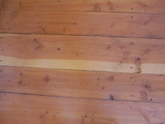 Douglas-Fir floor with clear caulking in cracks hand made by greenleaf craftsmen